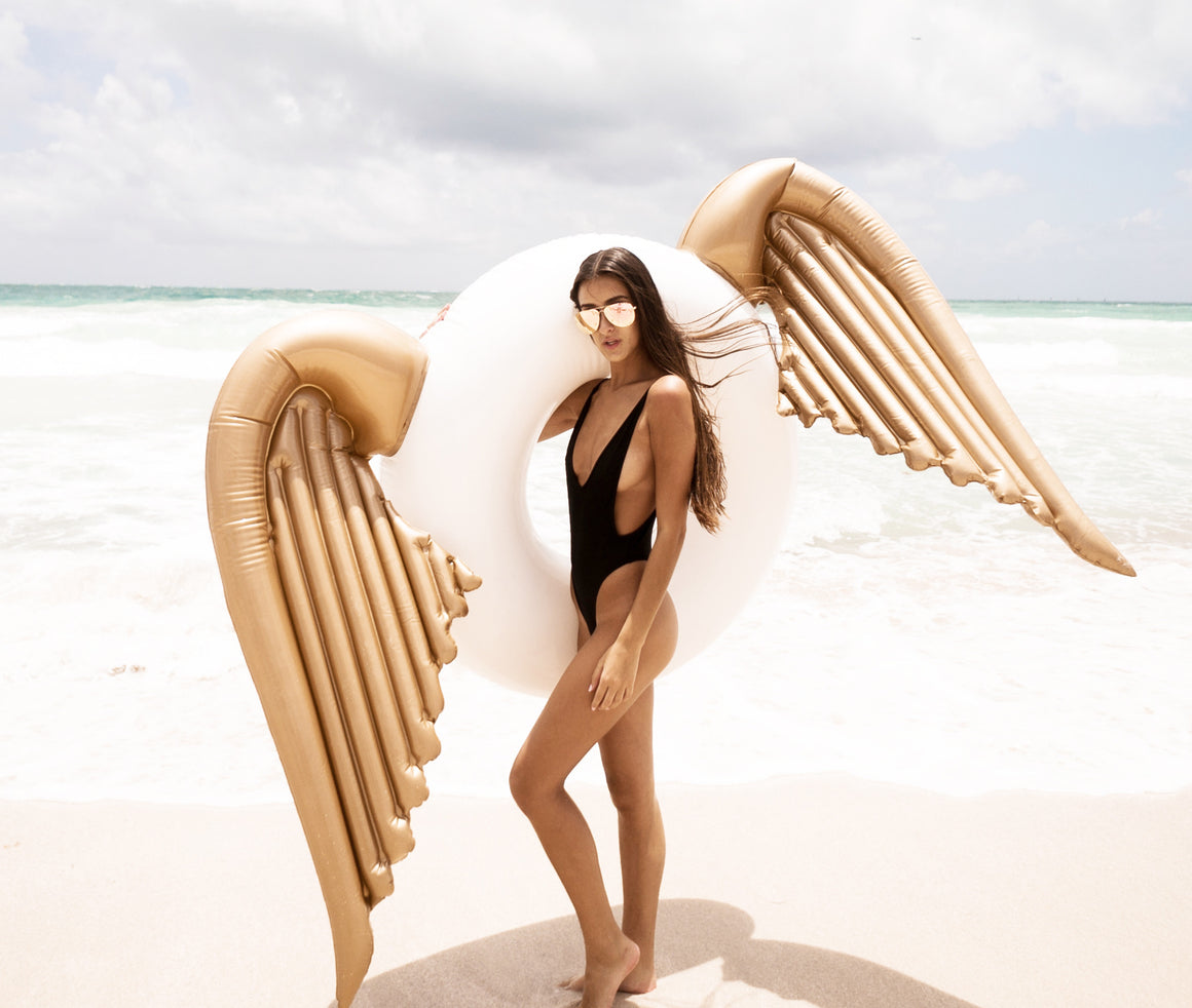 The original angel wings pool float by Mimosa Inc