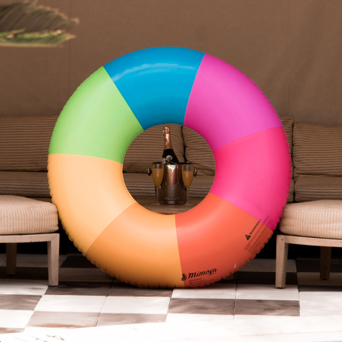 tutti frutti rainbow pool float by Mimosa Inc