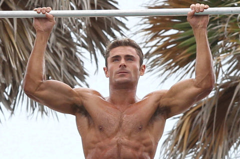 Zac Efron does a pull-up. Photo: Splash News
