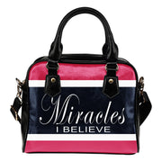 Miracles I believe blue, pink and white shoulder handbag