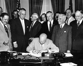 President Ike signing the Documents