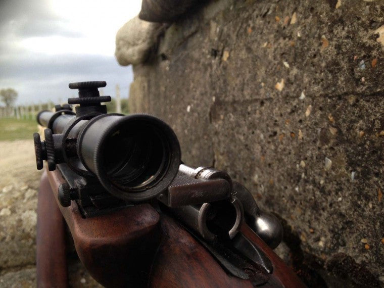 A malcolm short scope mounted offset on an old rifle