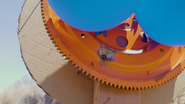 The flywheel showing an impact that popped an earlier balloon
