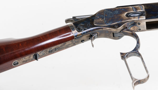The lever and underside of the Winchester 1873
