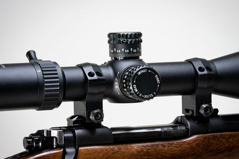 a scope mounted on a rifle, emphasizing the turret block