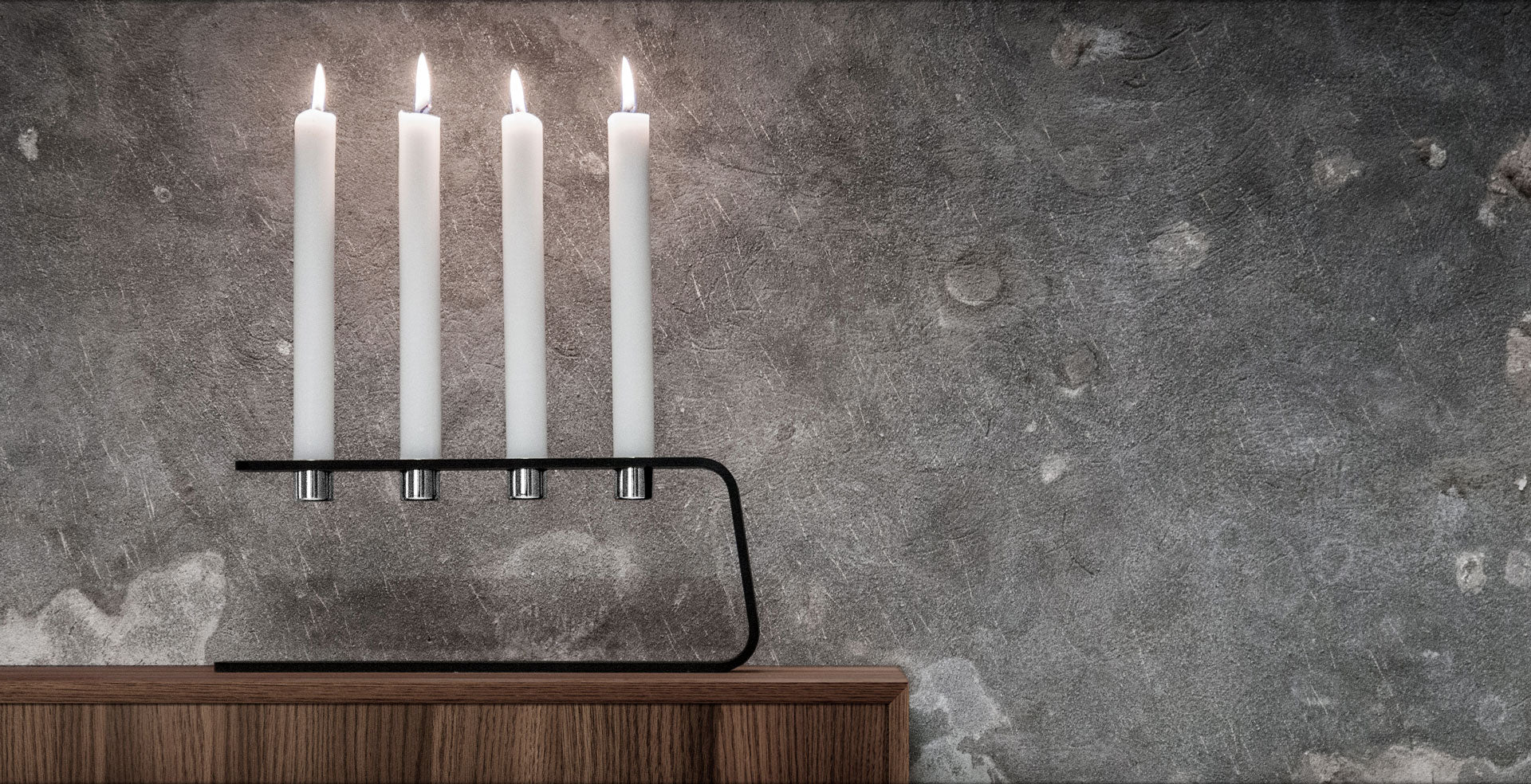 The maskulin Vinkel 4 Candle holder on concrete background - use this for advent