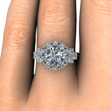Overhead view of engagement ring on a finger