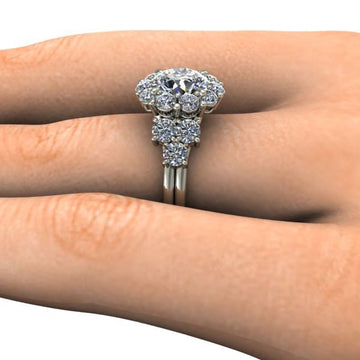 Side view of engagement ring on a finger