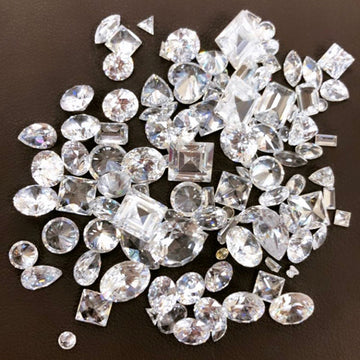 Pile of loose diamonds in variety of shapes