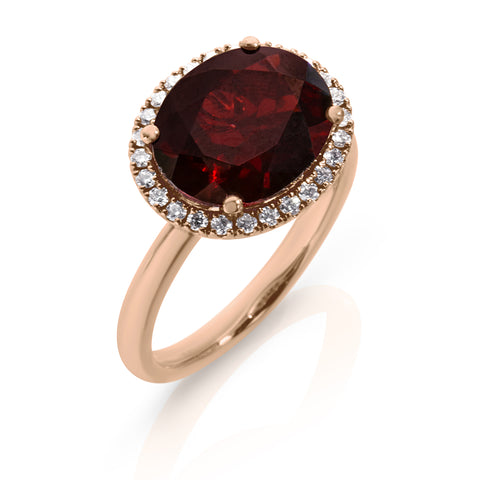 Oval Garnet with diamond halo
