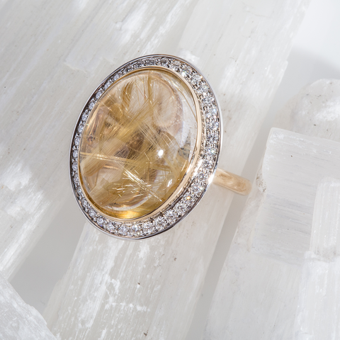 Oval Rutile Quartz and diamond ring