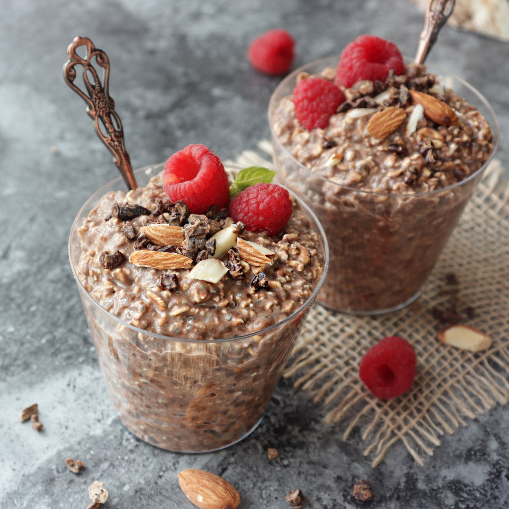 Maca Overnight Oats Topped with Cocoa, Almonds and Raspberries