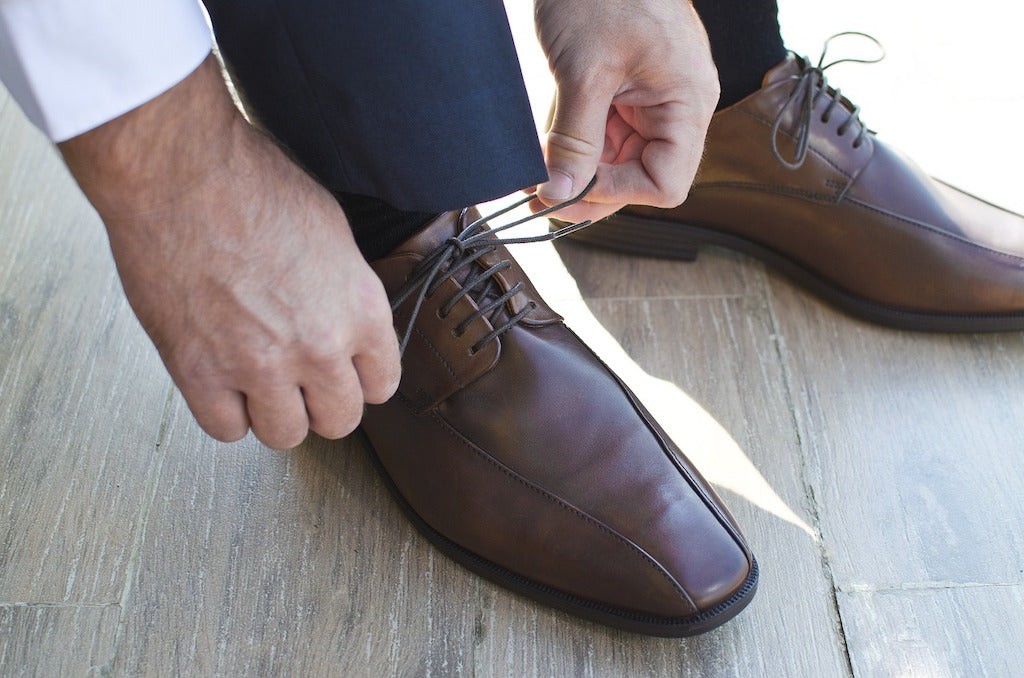 Best Socks for Smelly Feet - Brown Shoes being tied