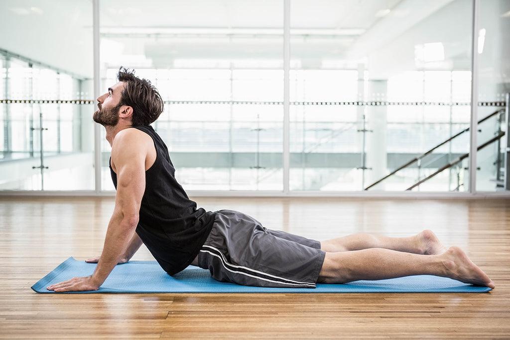 How to Manage Back Sweat - Guy Doing Yoga