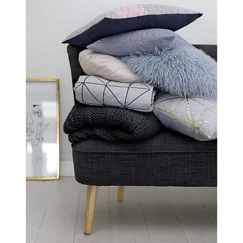 Scandinavian black cable knit throw lifestyle