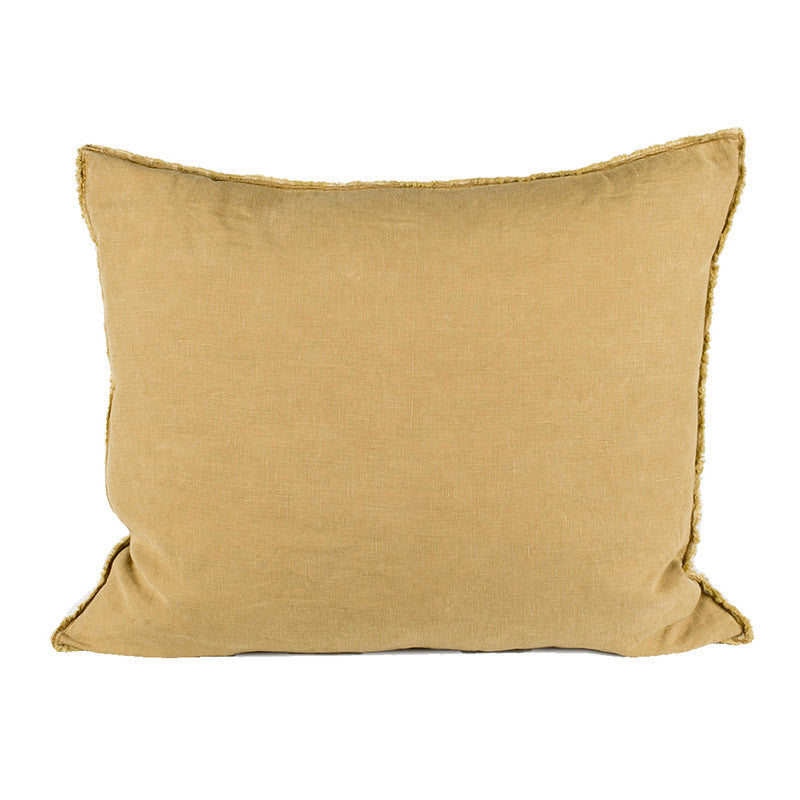 Scandinavian linen pillow with frayed edge detail ochre