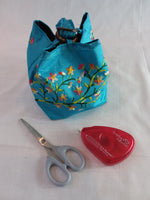 Embroidered silk bag, coconut shell fastening with carry handle - aqua - Memories and Photos