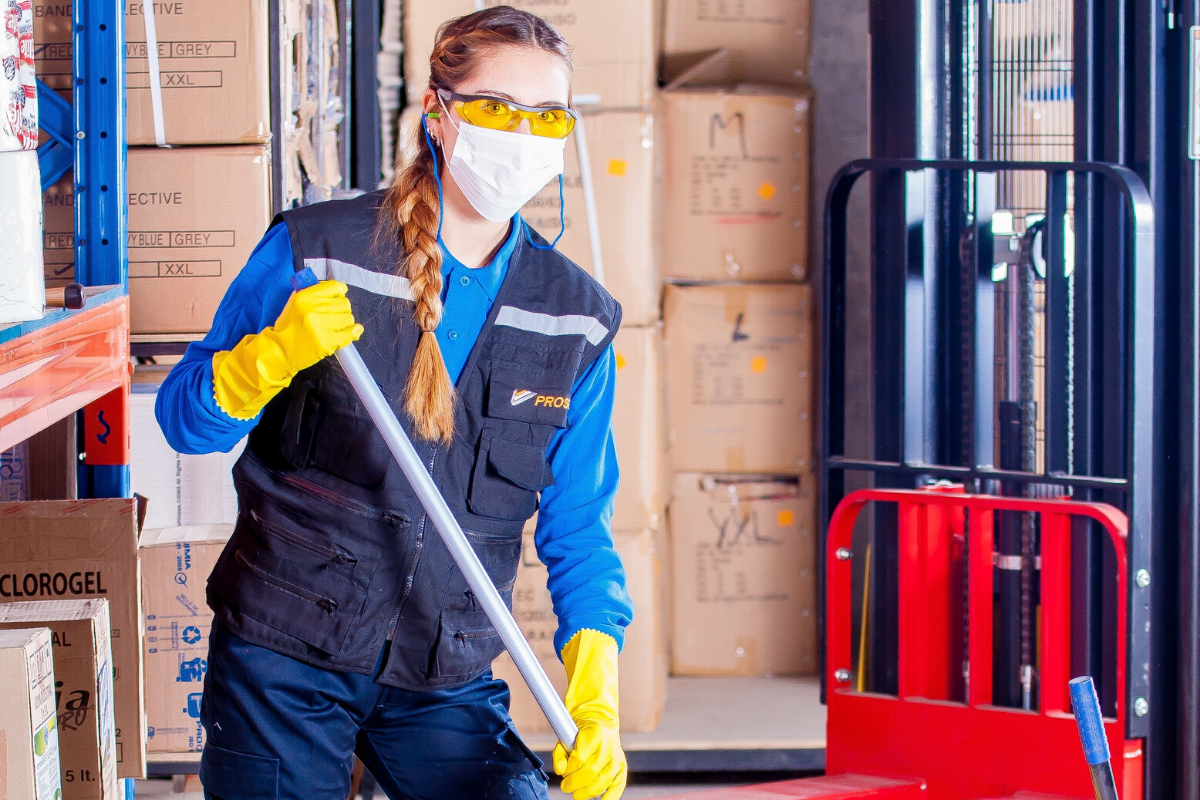 warehouse staff in protective clothing for coronavirus