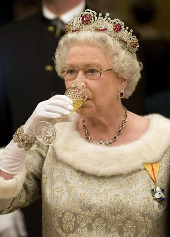 The Queen driving champagne