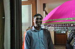 Lovely Jairam inspecting pink and gold parasols