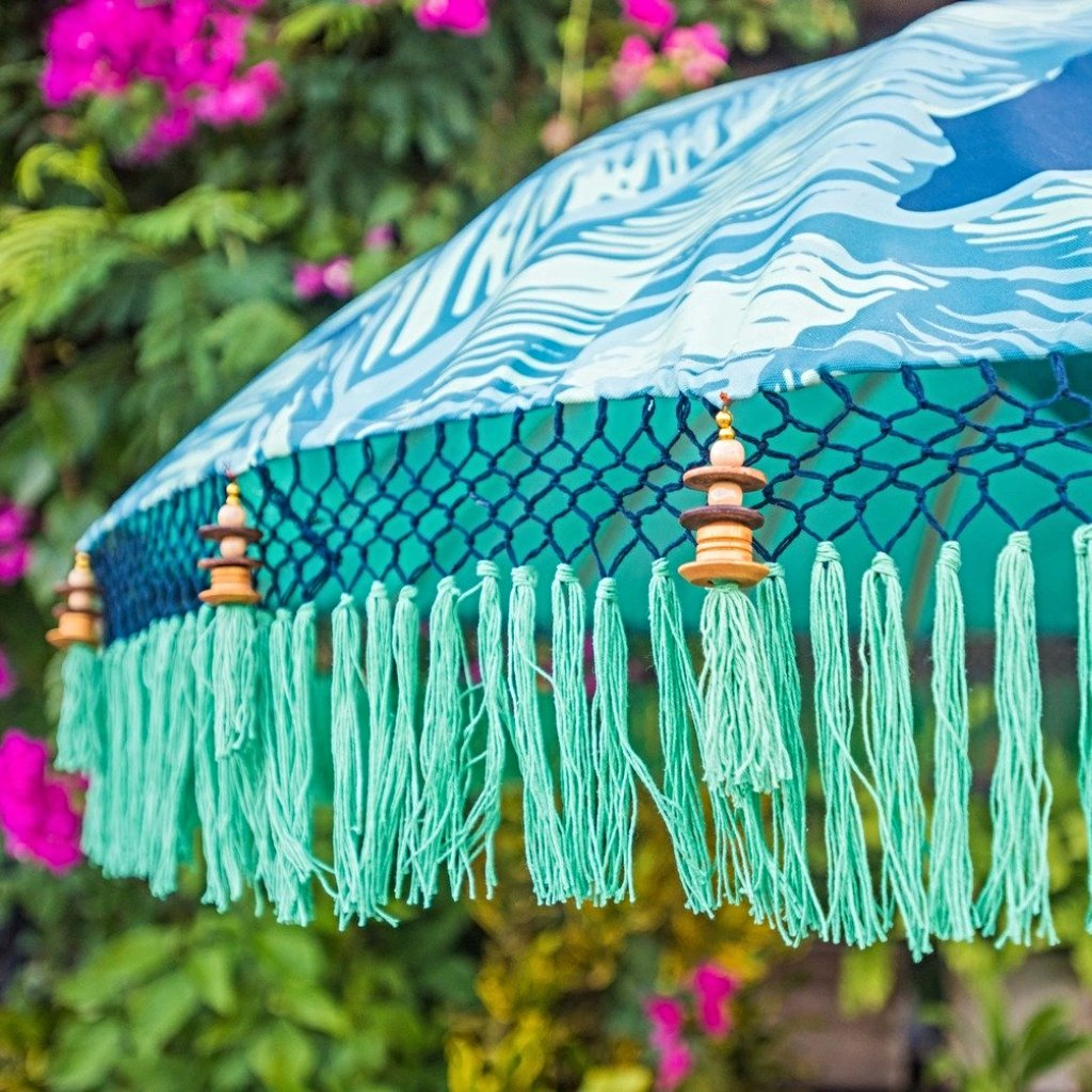 Nina parasol. Digital printed waterproof canvas dark blue palm leaf banana leaf design blue and green. East London parasol company garden umbrella made in bali. Side view