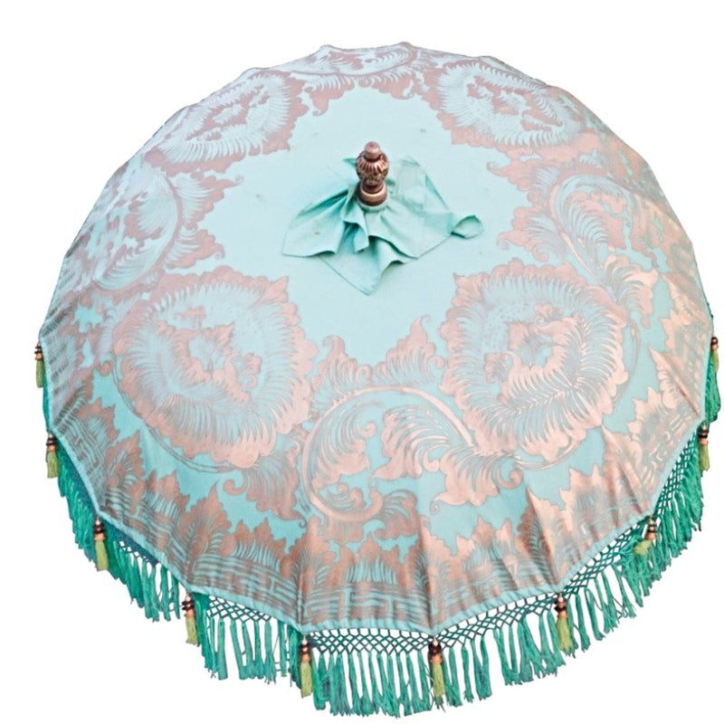 Tracy parasol garden umbrella or parasol for east london parasol company. Handmade in Bali. Colours are green, gold and blue with carved wood.