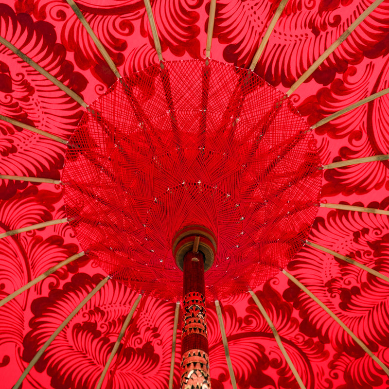 East London Parasol Company Bali Bamboo 2m garden umbrella. Red and Gold. Handmade and handpainted with fringing and tassels in shades red