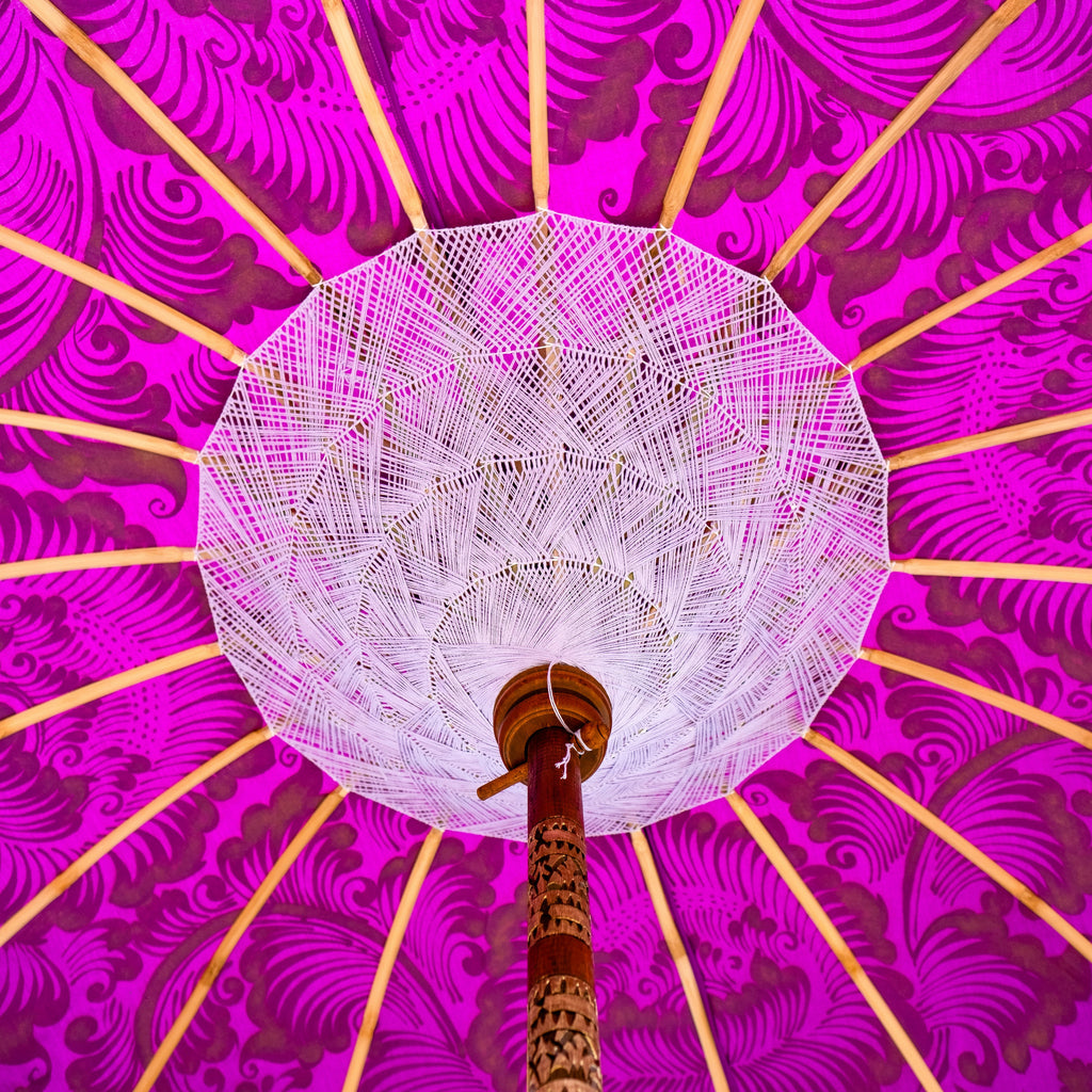 East London Parasol Arlo- purple twill Bali bamboo 2m garden umbrella with lotus design hand painted in gold ink. Tassels in shades of white, hand made. The perfect umbrella for picnics, gardens, summer, patios, pool side and terraces.