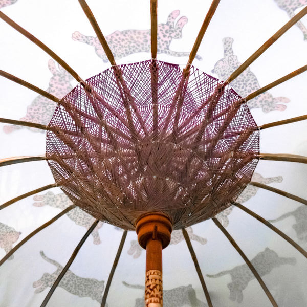 East London Parasol Company Bali Bamboo 2m garden umbrella. Racing leopards leopard print. Handmade and handpainted with fringing and tassels in shades of white
