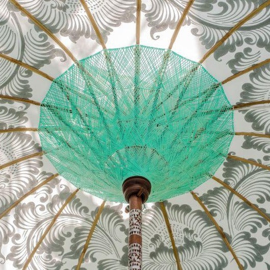 Cher white cream silver and mint green blue  garden parasol or umbrella hand painted with silver. Bamboo spokes, hand carved durian wood pole, Indian metal silver fringing and light blue cotton tassels. Pretty garden umbrella for picnics, gardens, festivals, weddings, terraces and pool side. Beautiful boho, bali parasol.