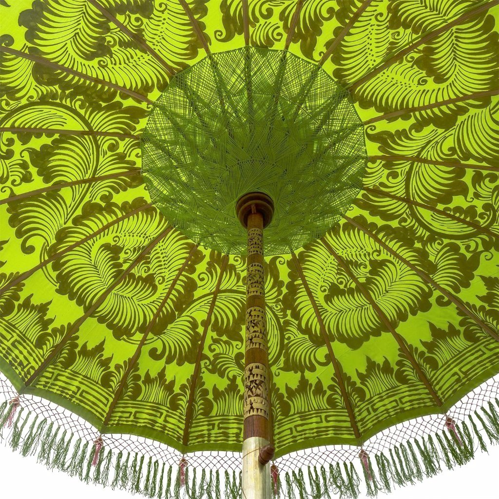 East London Parasol Jane parasol- lime green Bali bamboo 2m garden umbrella with lotus design hand painted in gold ink. Tassels in shades of green and pink, hand made. A beautiful, colourful and luxurious garden decoration to suit any pool, dining table, wedding or cocktail patio. A stylish summer accessory.