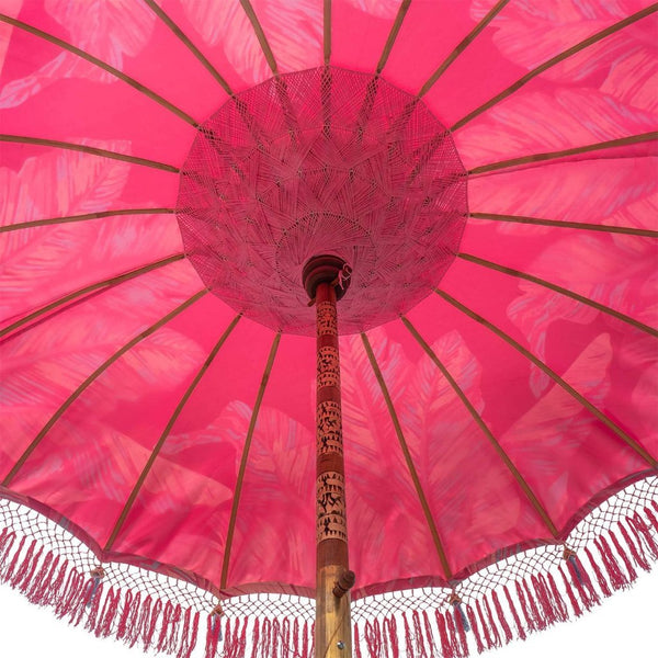East London Parasol Company Bali Bamboo 2m garden umbrella. Pink Nina, palm print with tassels on waterproof canvas