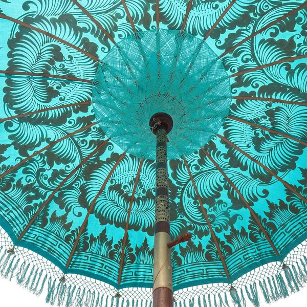 East London Parasol Bette- blue twill Bali bamboo 2m garden umbrella with lotus design hand painted in gold ink. Tassels in shades of blue, hand made. The perfect umbrella for picnics, gardens, summer, patios, pool side and terraces. A very pretty parasol and colourful, luxurious garden decoration for a fabulous summer.