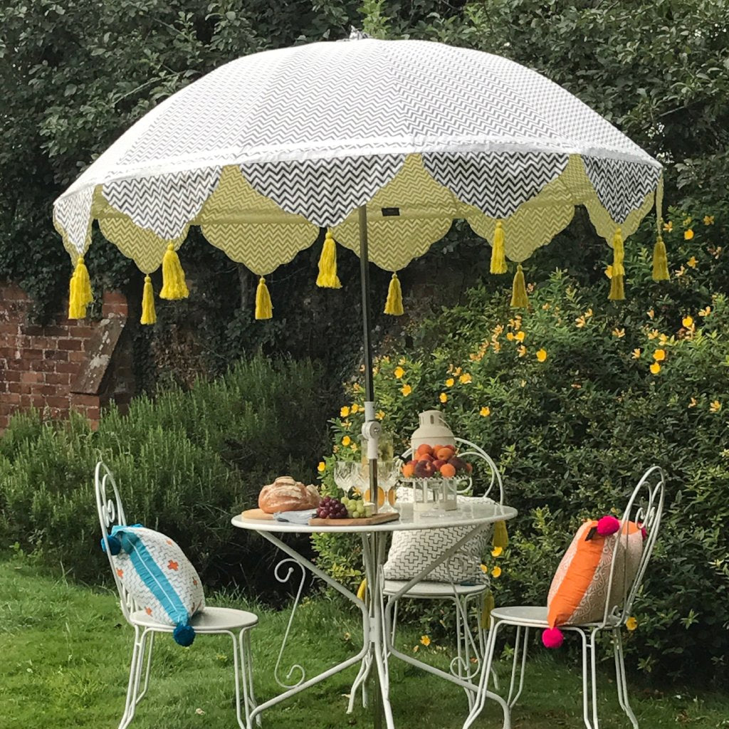 East London Parasol Company Aretha  hand made Indian garden parasol. 2m garden umbrella Charcoal grey zig zag hand block printed cotton, lined with yellow. With silver ribbons and yellow tassels. Metal frame and tilt mechanism. Pretty garden umbrella, table, picnic, terrace, wedding, festival or pool. A stunning summer feature.