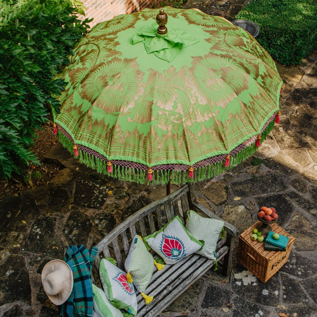 Lime and pink garden decoration, East London Parasol Company Jane parasol and suzani cushion.