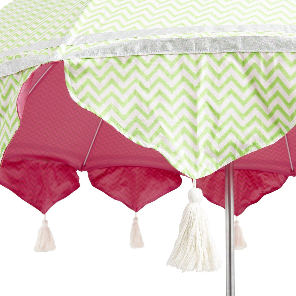 East London Parasol Company. Green aretha zig zag and pink garden umbrella. Cotton block print with natural cotton tassels and tilt mechanism.