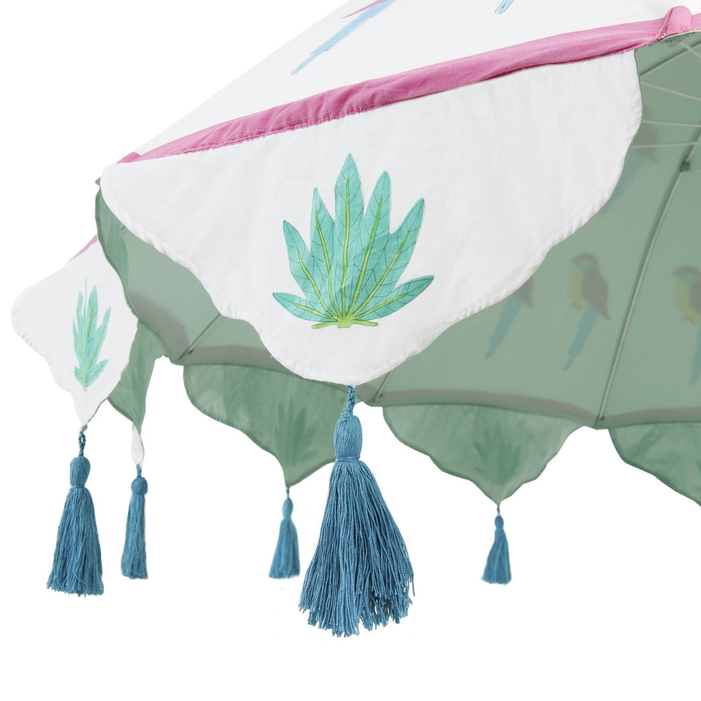 East London Parasol Company 2m David garden umbrella, cotton parrot block print with tassels on tilting metal frame.