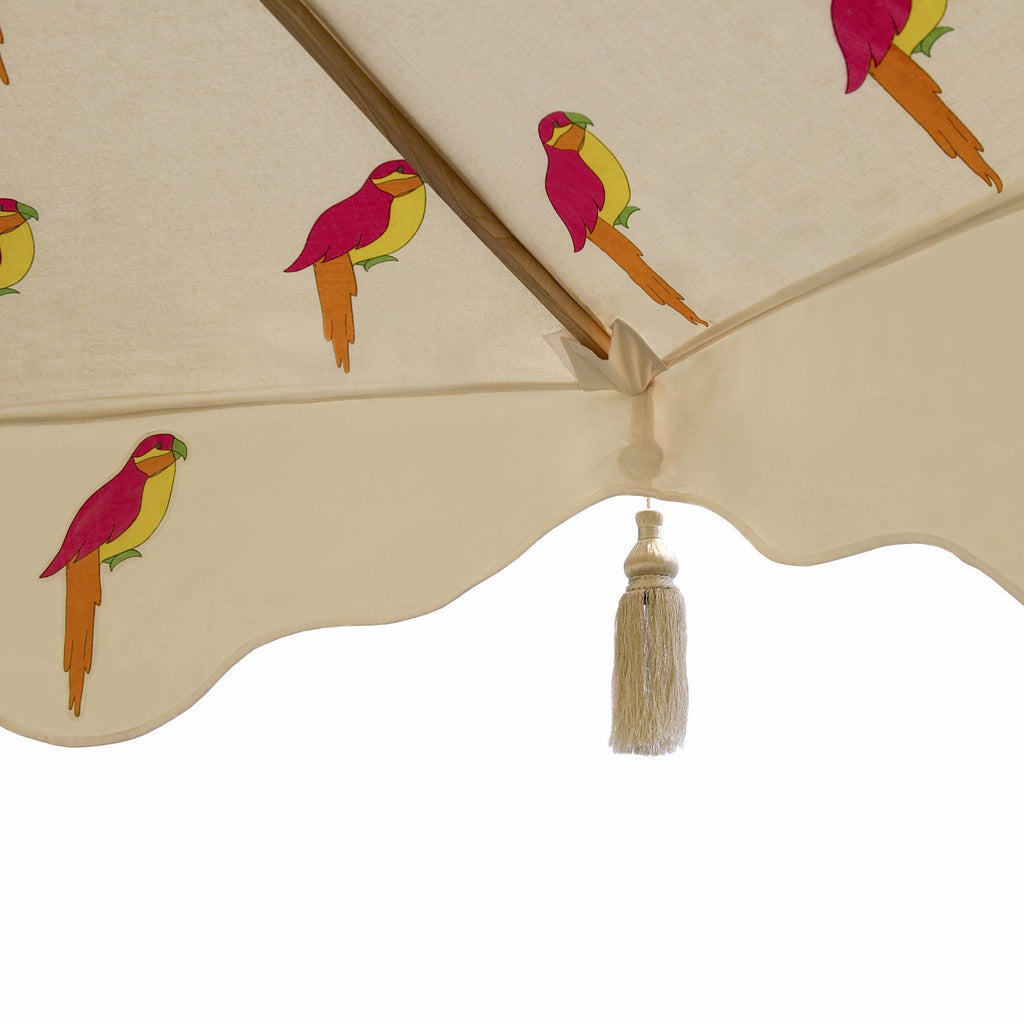 East London Parasol Company. Big David. 3m printed cream waterproof canvas colourful parrot wooden garden parasol. Different interchangeable covers available  Printed natural coloured waterproof cotton canvas with parrots underneath, Arabian-influenced fringe and silver beige tassels. The perfect garden umbrella for gardens, summer, patios, pool side and terraces.