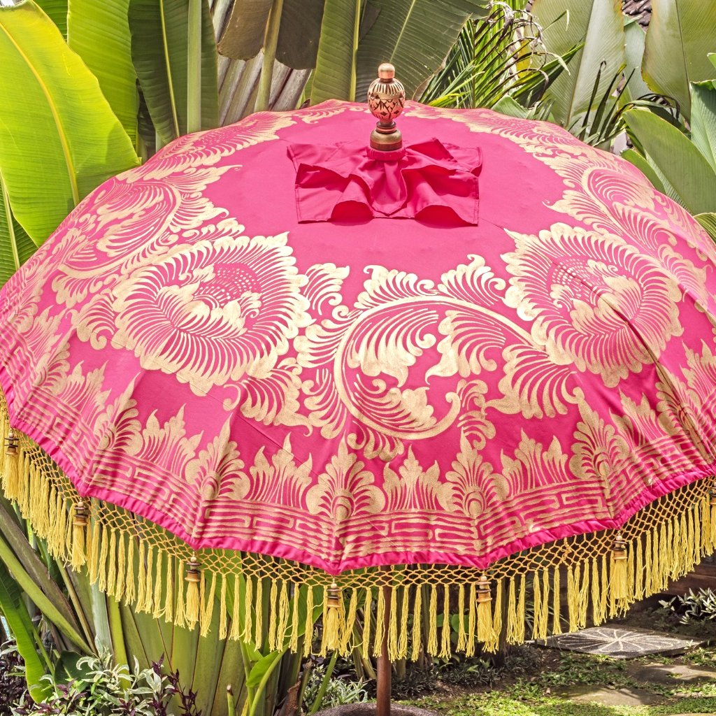 East London Parasol Company Whitney- pink orange and yellow bali parasol. Handmade garden umbrella. A show stopping garden decoration and the most pretty summer accessory for a garden party or a wedding.