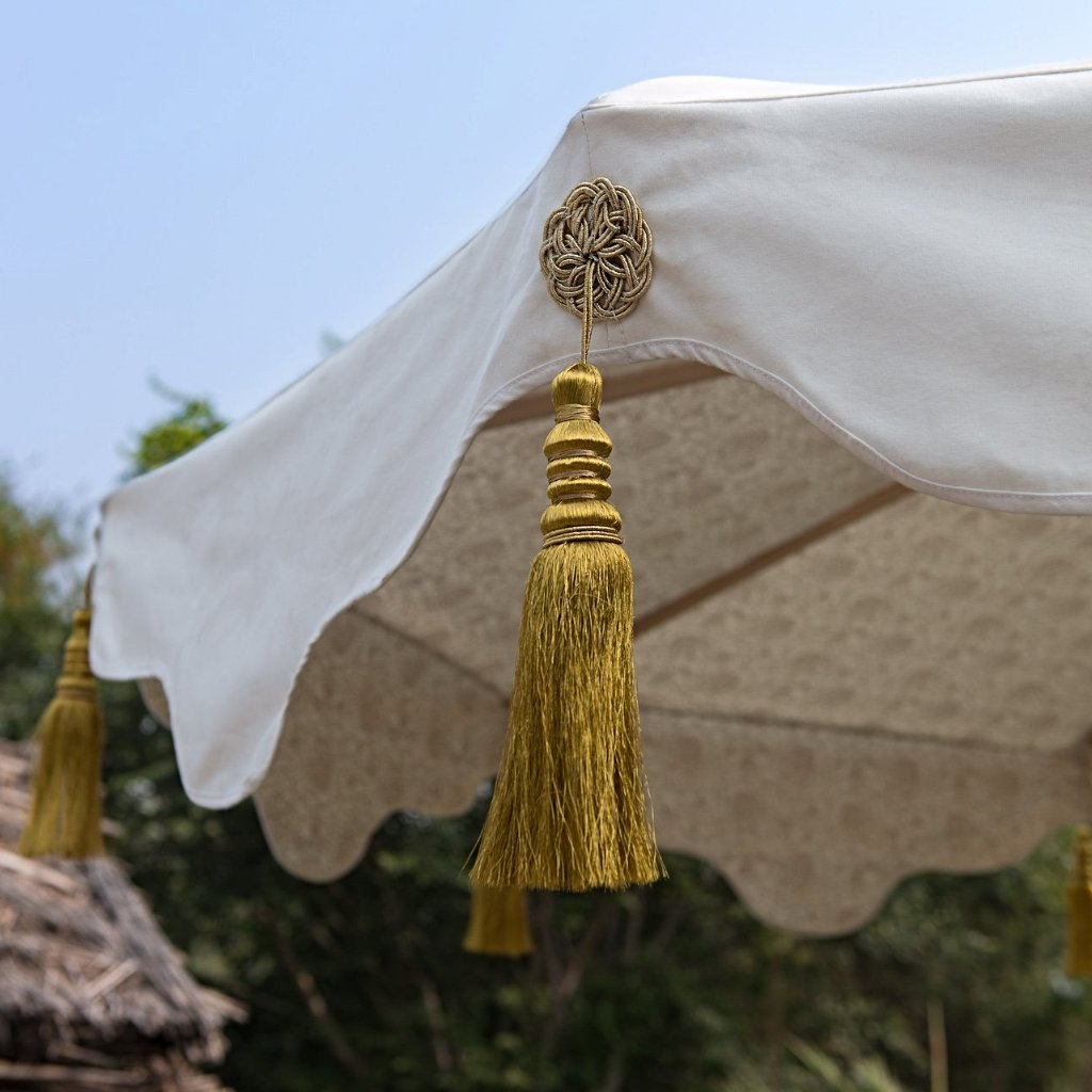 Big Liberace garden umbrella or parasol. Made in India. Gold floral block print, cream waterproof canvas and gold tassels. Wooden framed