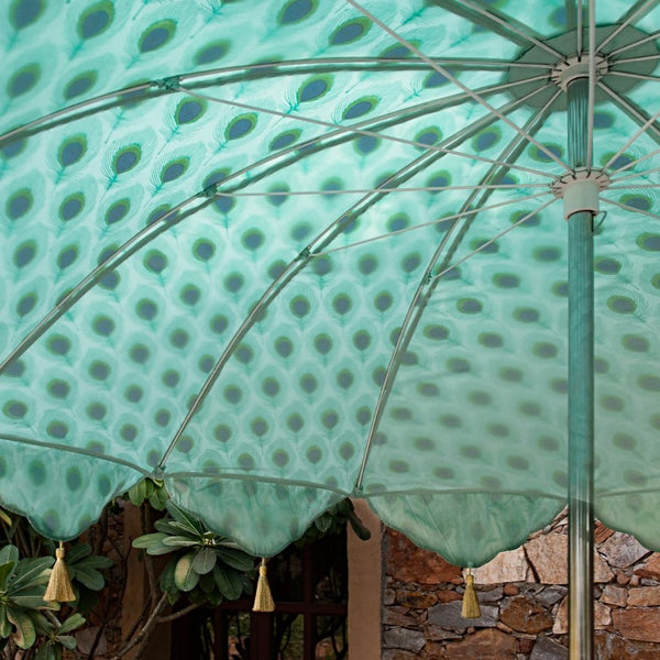 Marvin- Gorgeous Indian parasol perfect for a picnic, patio, through your table with an umbrella hole or by your sun lounger at the pool. Hand block printed peacock pattern cotton, golden green taffeta and with handmade gold tassels. A metal frame with tilt mechanism. The most pretty print summer decoration feature and luxurious accessory.