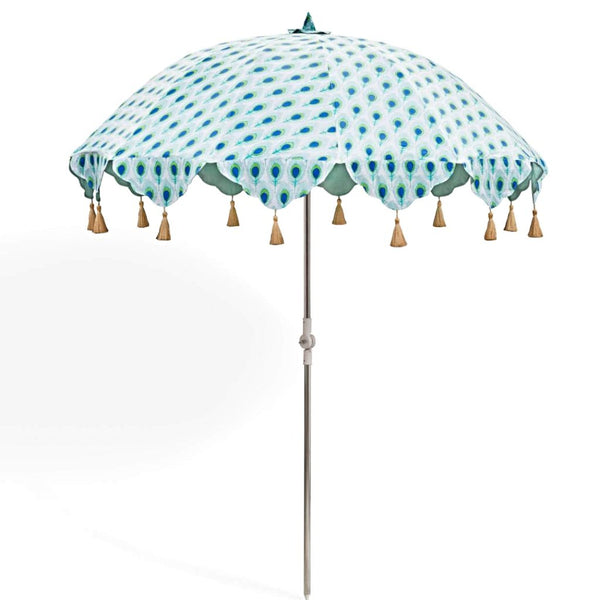 Marvin parasol hand block printed in India on cotton. Peacock print in blue green and gold with gold tassels. Metal frame that tilts