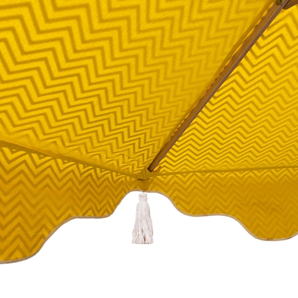 East London Parasol Company wooden frame Big Aretha umbrella or garden parasol. Grey zigzags chevrons with yellow and natural cotton tassles