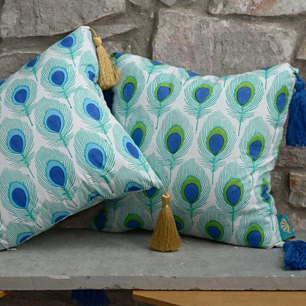 green blue and turquoise peacock tassel cushions from East London Parasol company. With gold tassles block printed in India