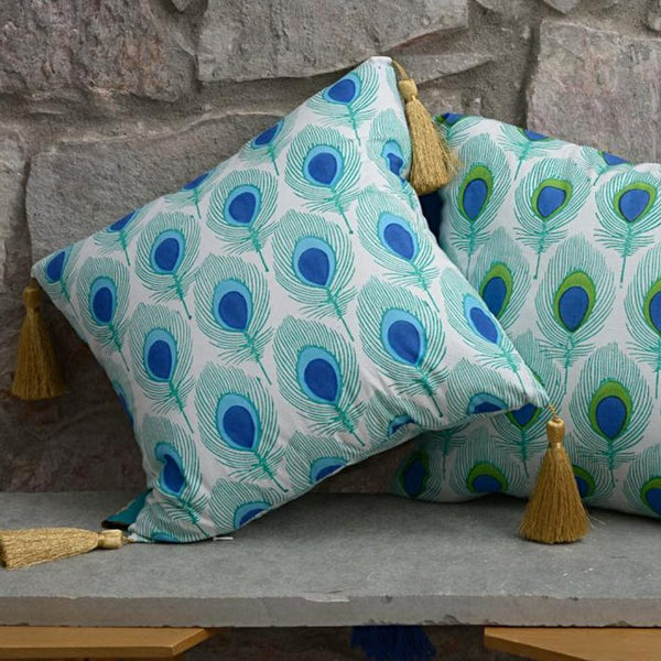 Turquoise peacock tassel cushions from East London Parasol company. With gold tassles block printed in India