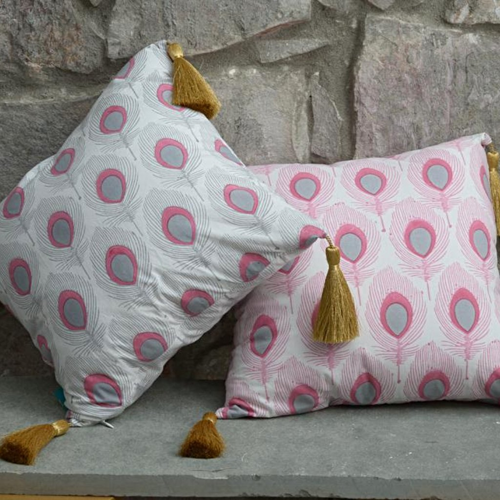 Grey and pink peacock cushion from East London Parasol company. With gold tassles block printed in India