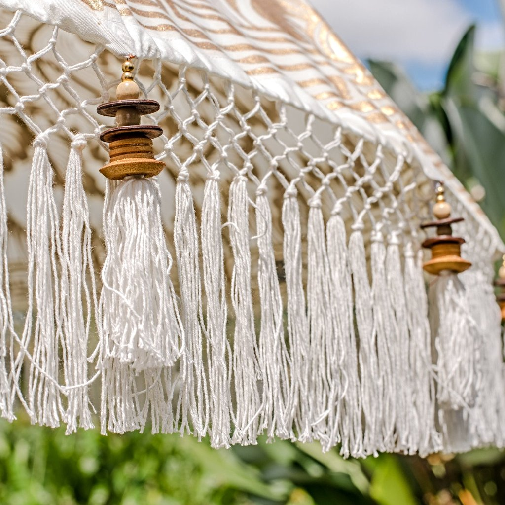 Liberace parasol white and gold garden umbrella from Bali for East London Parasol Company