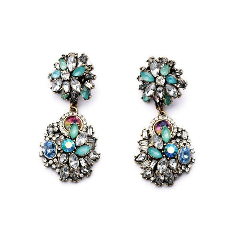 MAGNIFCO CRYSTAL STUDDED STATEMENT EARRING - SWANL