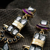 STRIKER STATEMENT EARRINGS - SWANL