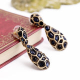 CHEETAH STATEMENT EARRINGS - SWANL